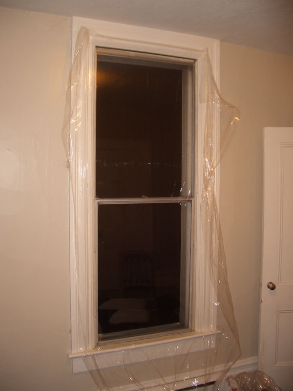 Winterizing sealing up old windows with plastic shrink for Window plastic